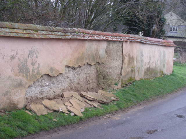 Witchert wall, in Nether Winchendon, typically needing regular maintenance to retain its weatherproof plastering and tiled cover.